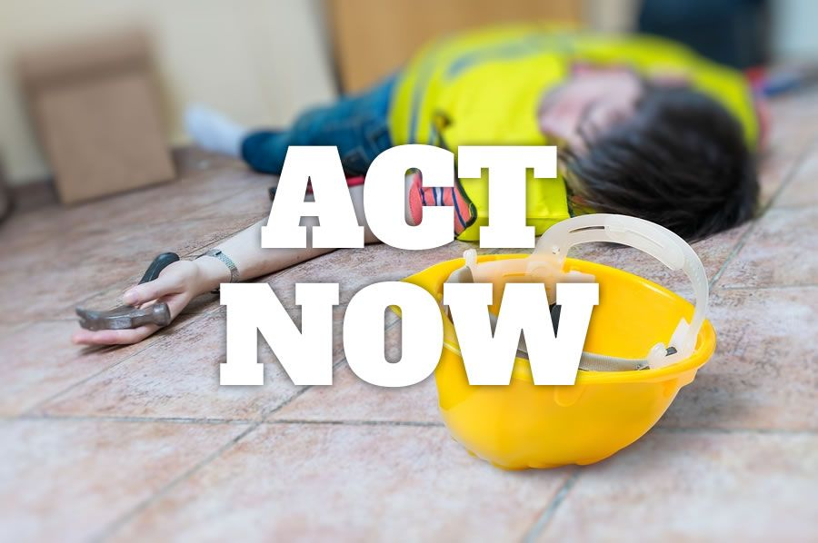 An injured worker lying on the floor