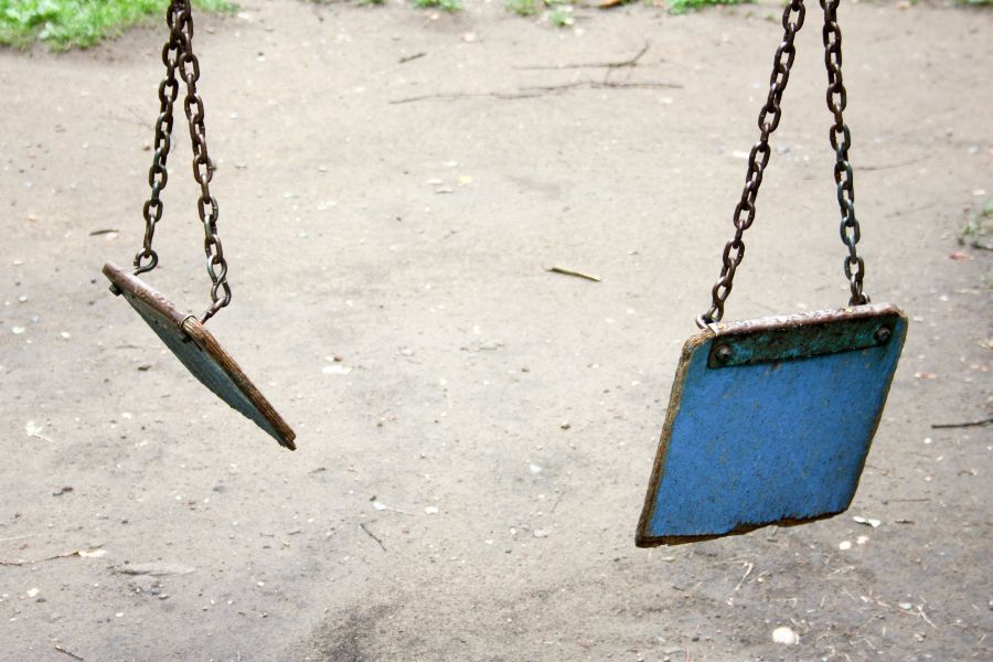 A child's swing broken into two pieces