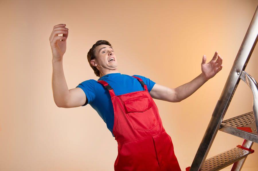 A man falling off a ladder
