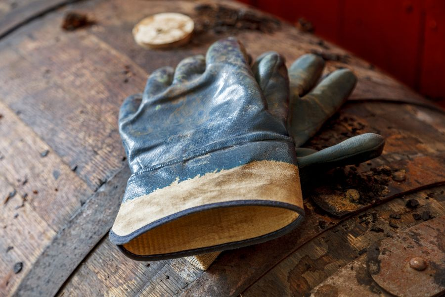 Gloves on a dusty whisky barrel