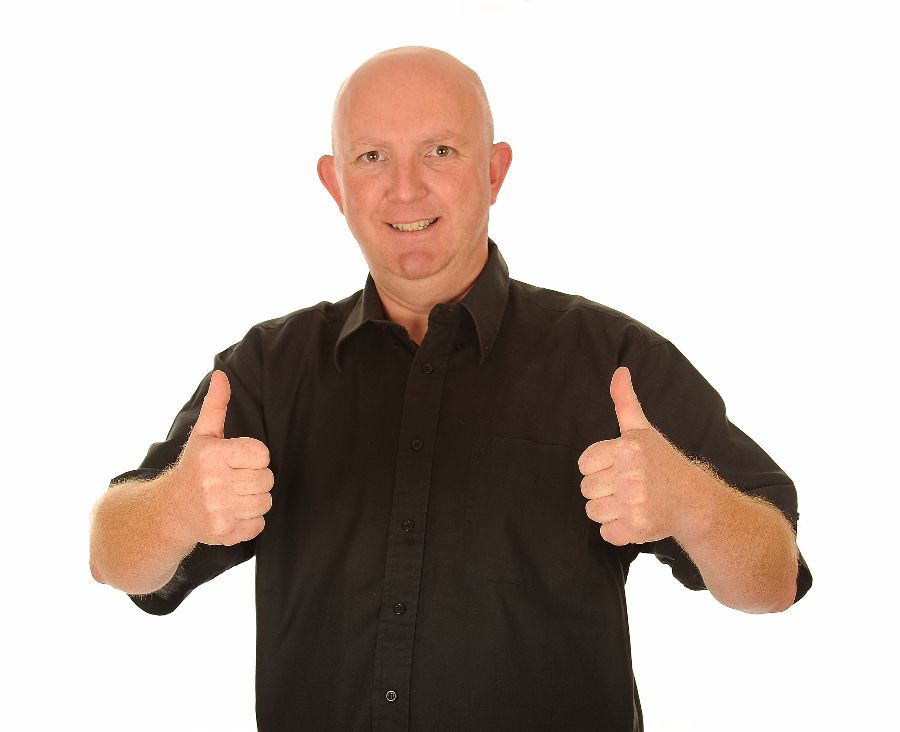 A happy looking man giving a thumbs up gesture