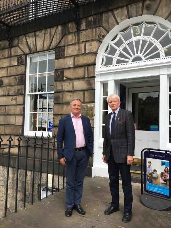 Edward McLeish (right) with the firm's David Harris on a visit to Allan McDougall Solicitors, June 2017
