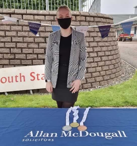 Heather Webster representing Allan McDougall Solicitors at the Scottish Disability Sport athletics championships