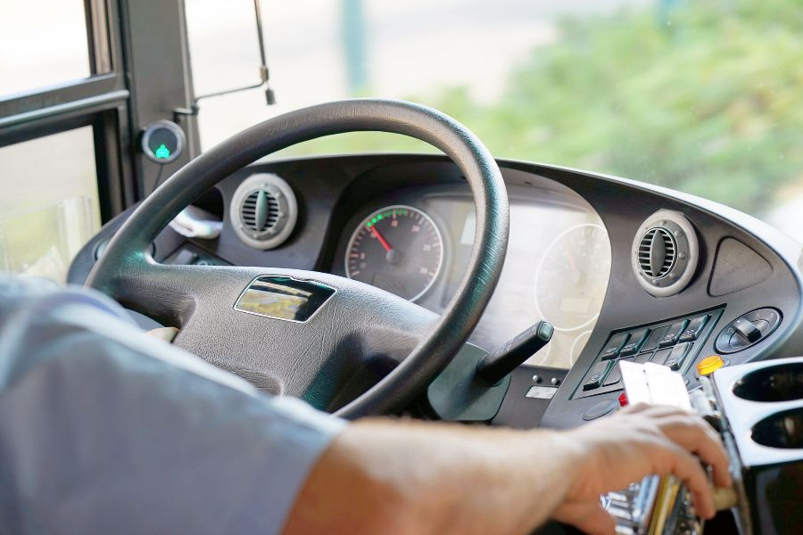 Close-up of coach steering wheel and dashboard